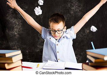 Boy throws away papers with homework failure - Boy throws...