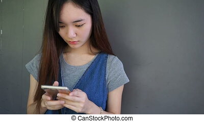young asian chinese woman enjoy using smart phone