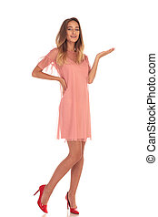 full body picture of a smiling young woman presenting - full...