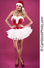 Beautiful santa claus with legs crossed at ankle