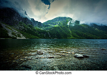 Lake in mountains. Fantasy and colorfull nature landscape....