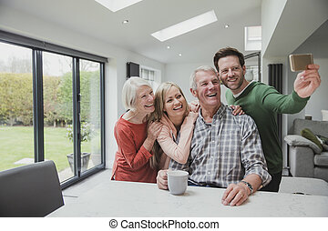 Family Selfie At Home - Happy family are taking a selfie...
