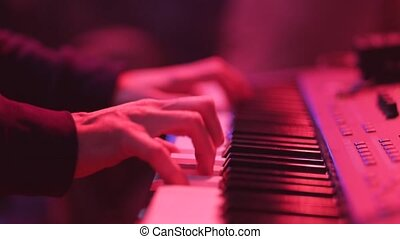 Piano keys. Musicant play the piano on the concert