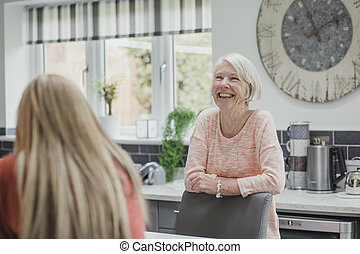 Senior Woman Enjoying A Catch Up With Her Daughter - Senior...