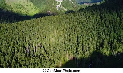 fligh over cableway in mountains - fligh over cableway in...