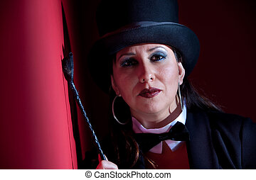 Woman with whip wearing a top hat - Woman dressed like a...