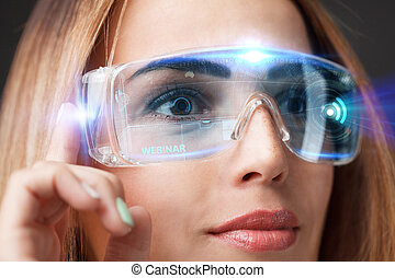 Young businesswoman working in virtual glasses, select the...