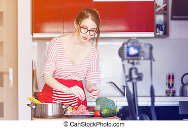 woman cooking for Video-sharing website - Young caucasian...