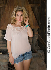 Blonde - Pretty young blonde in a cream colored blouse