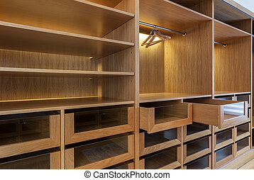 Wardrobe with empty drawers and shelves. Ready for use