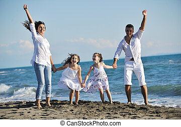 happy young family have fun on beach - happy young family in...