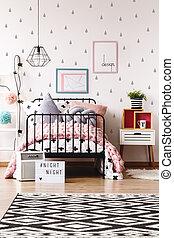 Pastel kids room with bed
