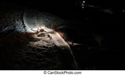 Smoothing Slopes At Night - smoothing down the ski slopes at...
