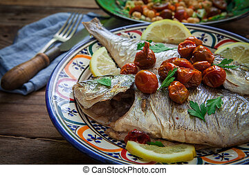Homemade seabass with parsley - seabass baked on oven with...