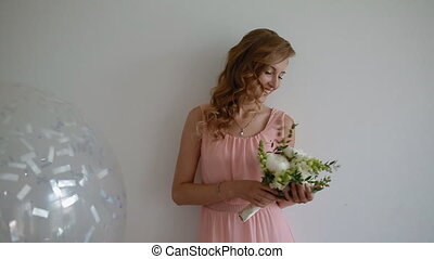 Portrait of caucasian bridesmaid with bouquet. Young woman...