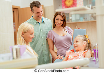 Family At The Dentist - Happy family at visit in the dentist...