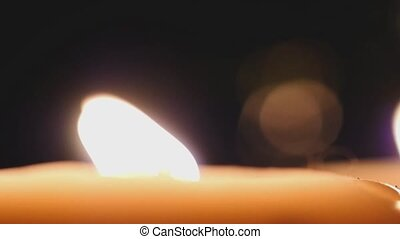 Candle burning with bokeh lights on the background. Romantic...