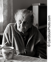 Elderly lonely woman - Old depressed woman. Black and white...