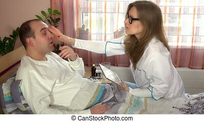 Plastic surgeon doctor examining her patient man before...