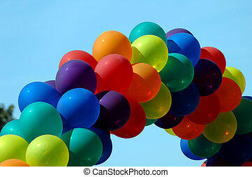 Pride Parade Balloons - Rainbow colored balloons in the sky...