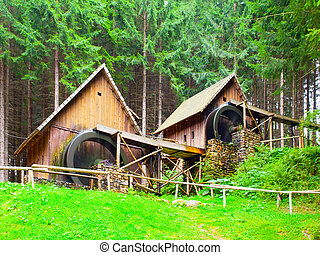 Gold ore mills. Medieval wooden water mills in Zlate Hory,...