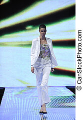 fashion show - beautiful young fashion model woman walking...
