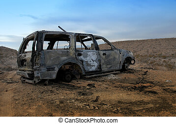 Burned Out SUV - An abandoned and torched SUV in the desert