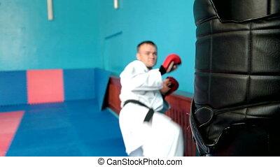 Karate fight - Martial artist doing a kick