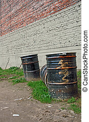 Urban Nuclear Waste - Large waste barrels in an empty lot