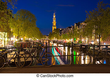 Westerkerk on the Prinsengracht Canal in Amsterdam at...