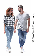 young people holding hands and walking forward. Concept of...