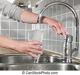 Filling a glass of water - Human filling a glass of water