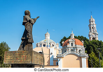 Statue and Guadalupe Church