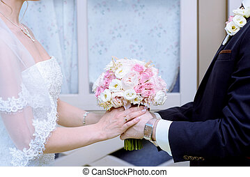Wedding couple with bouquet. Female and male portrait....
