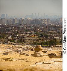 Sphinx Looks Onto Cairo City