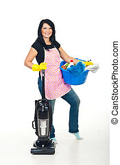 Cheerful woman holding cleaning products