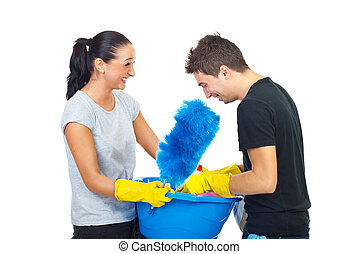 Couple with cleaning products having fun