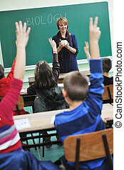 children in school - happy children group in school taking...