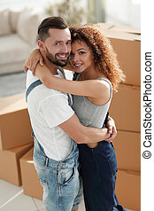 Portrait of a young couple moving into a new home