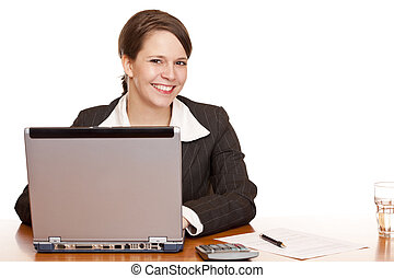 Young business woman sitting happy in office and works on...