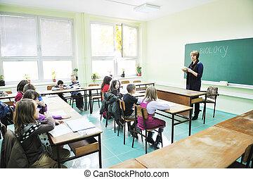learn biology in school - happy children group in school...
