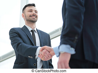 handshake of business partners after a favorable trade deal...
