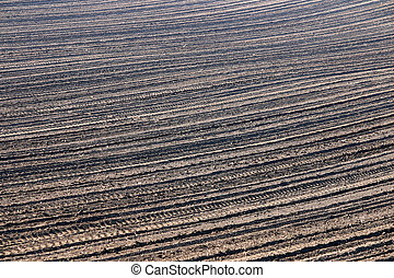 plowed field background agriculture industry