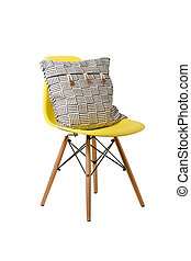 Backrest pillow on yellow color chair isolated on white...
