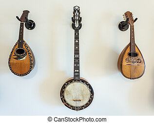 Stringed musical instruments on wall.