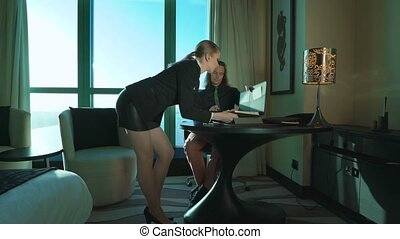 Sexy girl secretary brings documents to chief. Director...