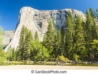 El Capitan - El capitan granite rock seen from the Yosemite...