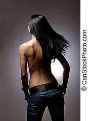 Hair flick - Beautiful hair from behind on studio background