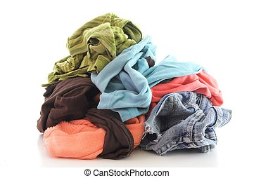 dirty clothing - a pile of dirty clothing isolated on white...