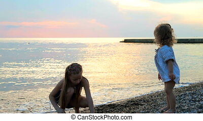 Two girls at sunset beach